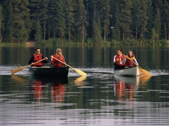 A group canoeing on Bear Lake in Crooked River Provincial Park near Prince George