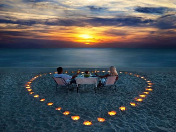 Create long-lasting memories with a candlelit dinner on the beach in the Maldives