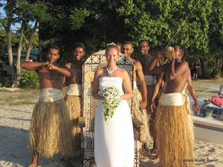 Fijian warriors to carry the bride on a decorated bridal chair