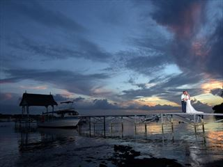 Beautiful sunset wedding on the jetty at The Ravenala