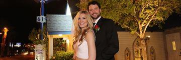 Bride and groom outside Graceland Wedding Chapel
