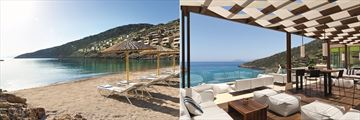 The beach and Crystal Box bar at Daios Cove Luxury Resort & Spa
