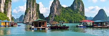Floating village by Rock Islands, Halong Bay