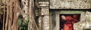 Monk exploring Angkor Wat