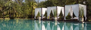 Swimming pool cabanas at The Sarojin Khao Lak