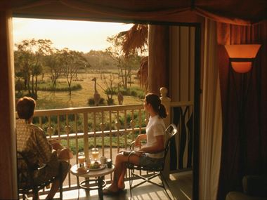 Disney Animal Kingdom Lodge guests looking at Savanna from their balcony