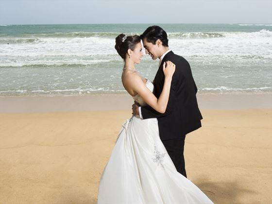 Couple embrace on the beach
