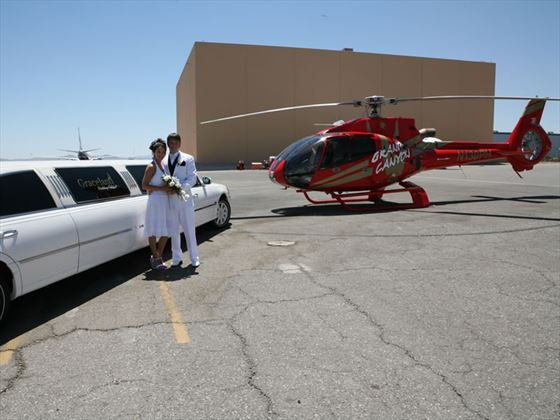 Bride and groom by Limo and Helicopter