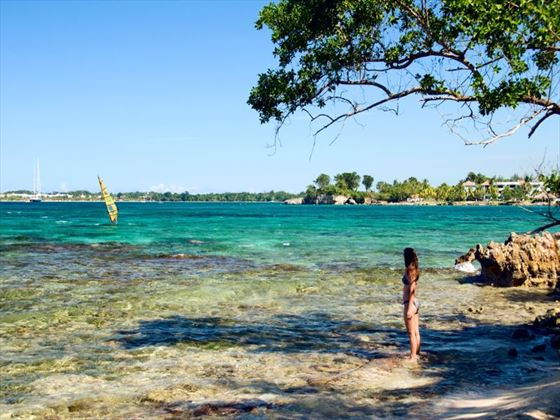 Woman standing on the beach in Negril