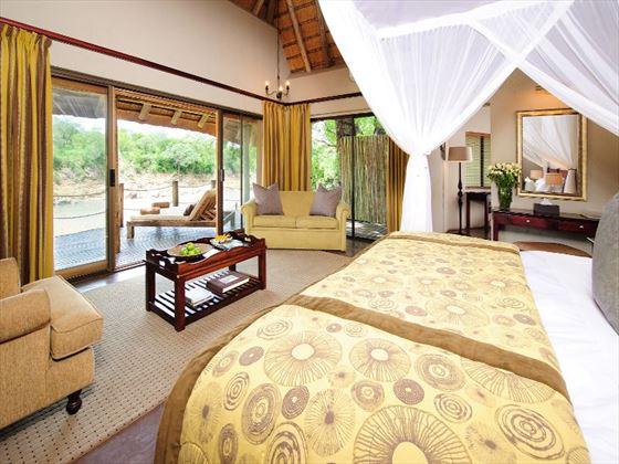 Bedroom and lounge area at Jock Safari Lodge