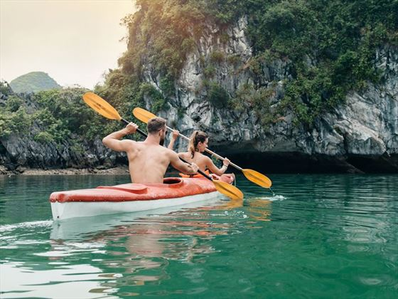 Couple paddling Halong Bay