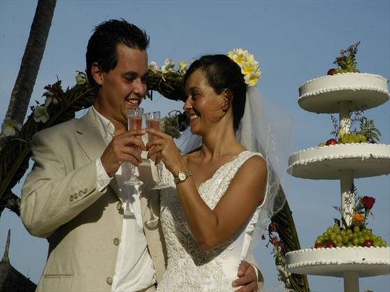 Couple toasting with champagne at Mombasa Serena Beach