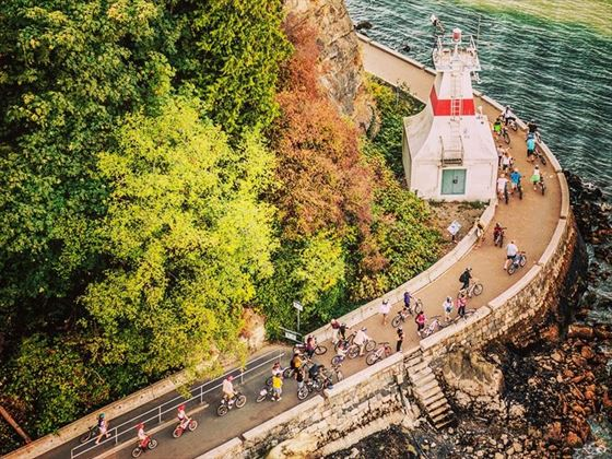 Cyclists make their way around Stanley Park Seawall