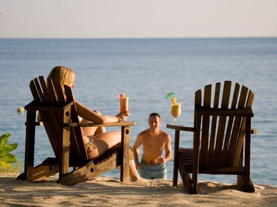 Honeymooners lounging on the beach, Denis Private Island