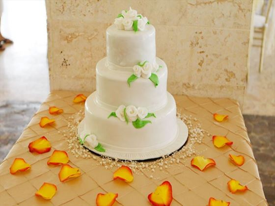 Wedding cake surrounded by rose petals