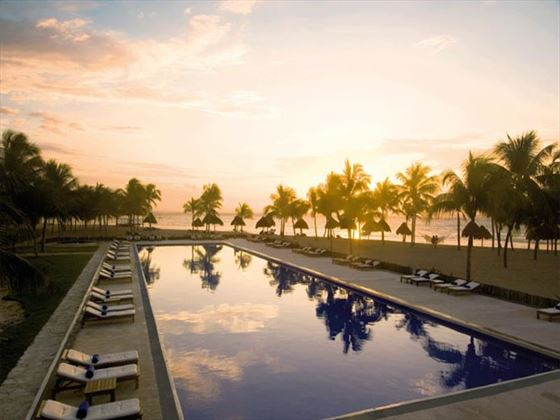Dreams Tulum outdoor swimming pool at sunset