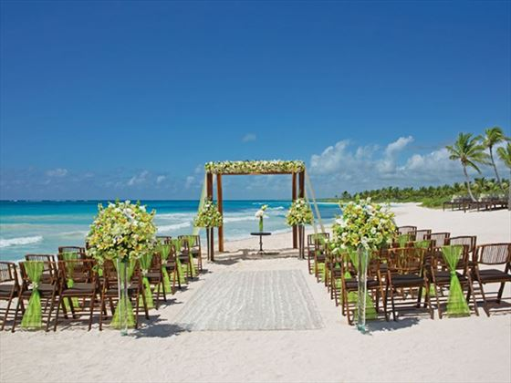 A tropical, yet elegant ceremony setup on the beach overlooking the sparkling Caribbean Sea.