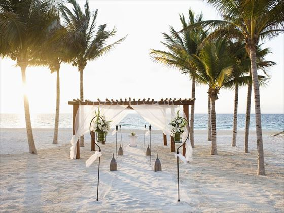Beach wedding setting at Excellence Riviera Cancun
