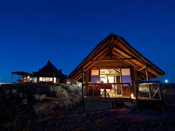 Exterior view of Kulala Desert Lodge at night