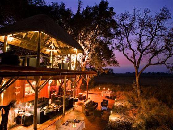 Exterior view of Xudum Delta Lodge at night