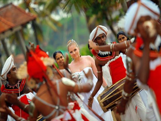 Bride surrounded by traditional Sri Lankan drummers