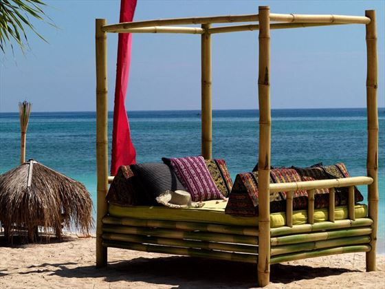 Bamboo cabanas on the beach at Hotel Tugu Lombok
