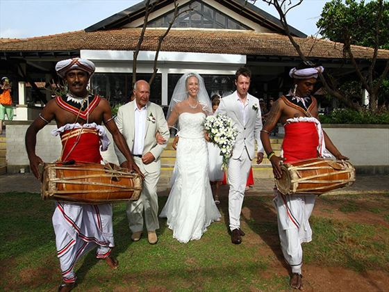 Bride being escorted by Kanydan dancers & drummers