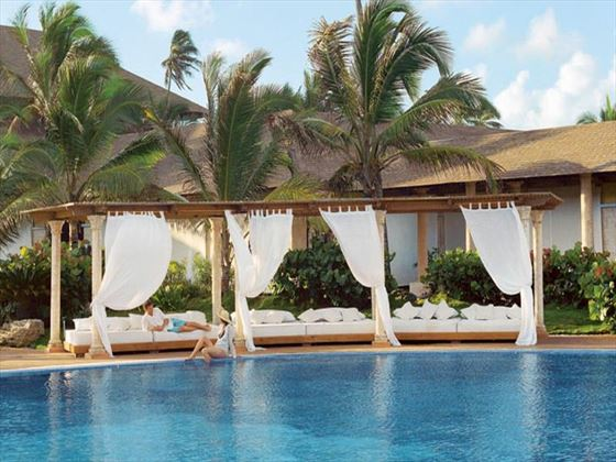 Lounge areas by the pool at Excellence Punta Cana