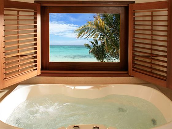 Honeymoon Suites at LUX* Le Morne come with a Jacuzzi with sea views