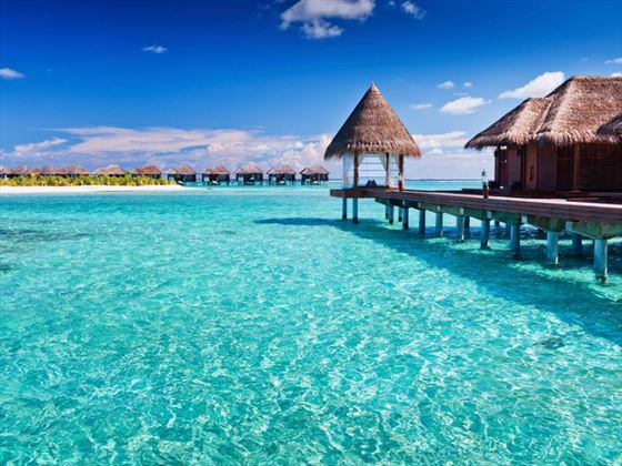 Maldives lagoon with overwater cabins