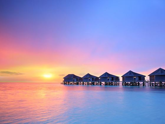 Maldives overwater villas at sunset