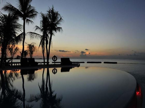 Nighttime view of the infinity pool at Komandoo Island Resort