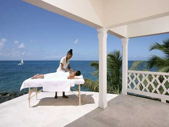Outdoor massage treatment at Curtain Bluff
