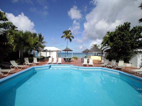 Outdoor swimming pool at Hawksbill by rex resorts