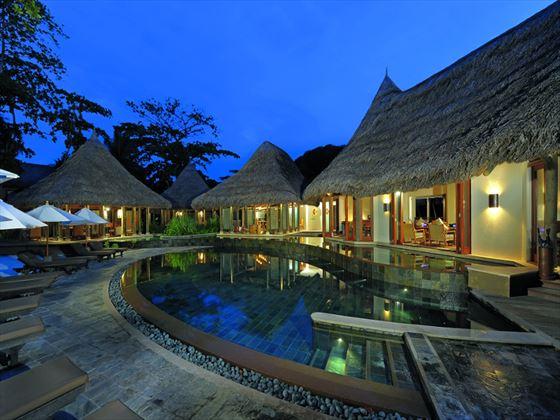 Pool area at night at Constance Ephelia Resort
