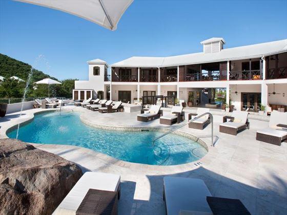 Pool with surrounding sunbathing area at Sugar Ridge