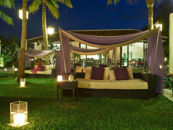 Poolside seating at Fusion Maia Da Nang