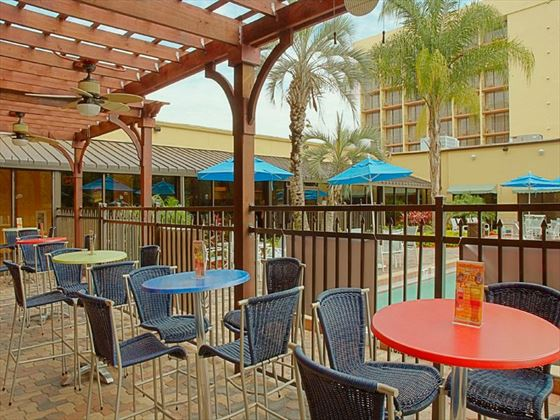 Poolside seating at Holiday Inn Main Gate East