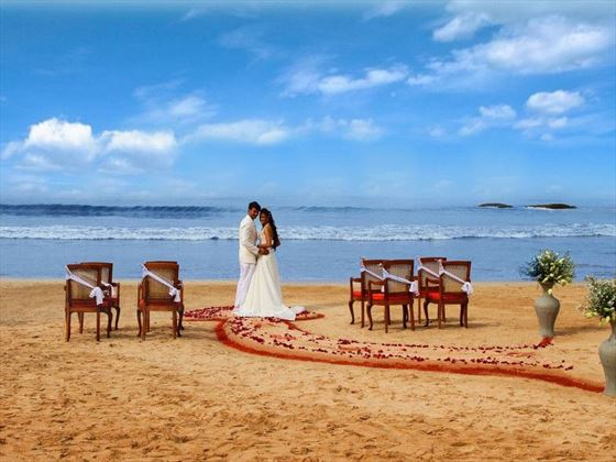 Wedding vows on the beach at Saman Villas