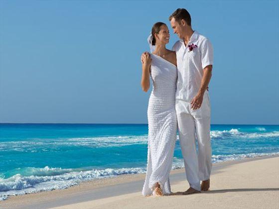 Bride & Groom strolling on the beach