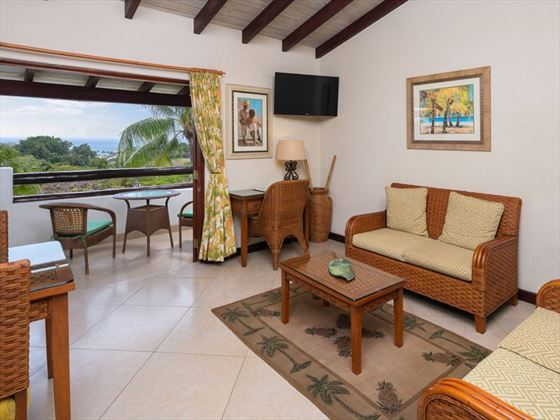 Ocean View Suite living room at Sugar Cane Club Resort & Spa