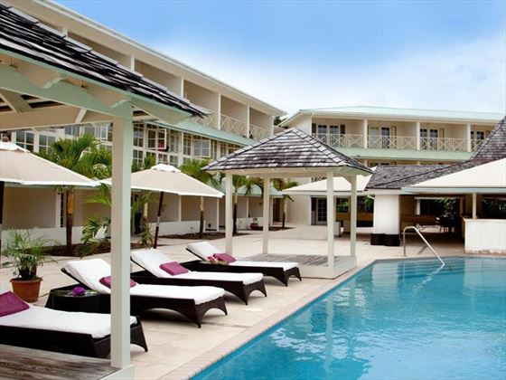 Surrounding pool loungers at blu St Lucia
