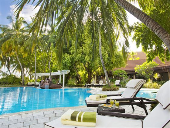 Swimming pool and sun loungers at Kurumba