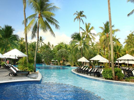 Swimming pool and surrounding sun terrace at Melia Bali