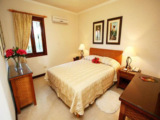 Typical bedroom at Sugar Cane Club Hotel & Spa