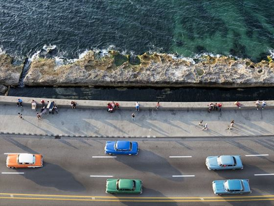 Vintage cars driving the Malecon, Havana