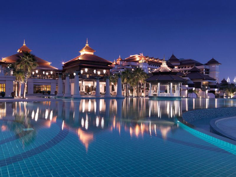 exterior view at night of anantara the palm