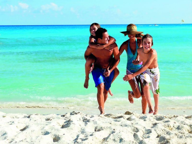 family at the beach at gran caribe real cancun
