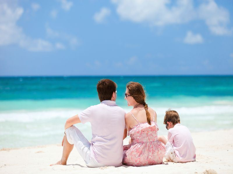 family on caribbean beach