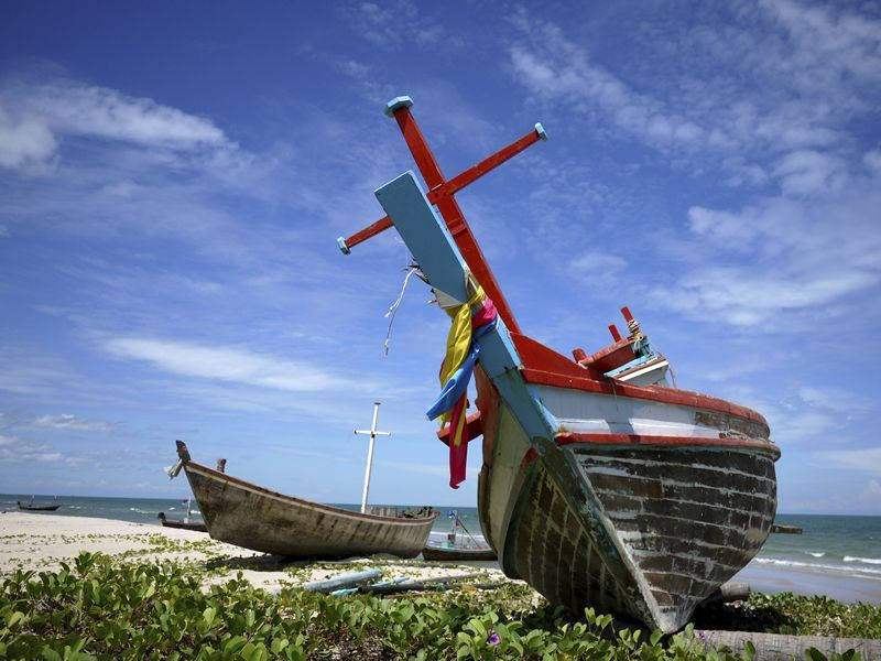 fishing boat on the beach in hua hin